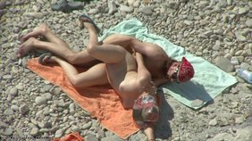 Horny blonde getting doggy style drilled by her hung boyfriend on a beach