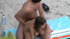 Brown-haired GF decides to low-key ride her boyfriend's hot cock on a beach