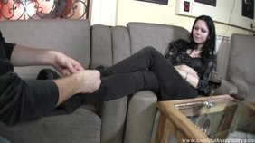 Pale-skinned hottie uses her feet to fuck her slave's throat