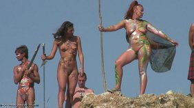 Various sexy nudists dress up as amazons or something