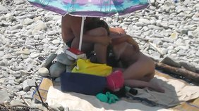 Check out that unrestrained and risky public sex on a beach