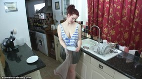 Playful redhead is used to seduce her man by doing chores topless