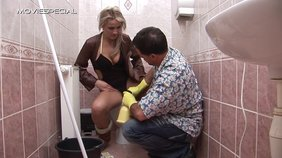 Cleaning guy catches smoking hot blonde masturbating on a toilet