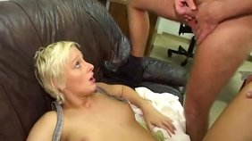 Short-haired MILF of a wife gets ass-banged from behind on a leather couch