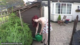 Sundress-wearing wife showing off her pussy up the skirt while doing some yard work