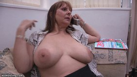Saggy tits wrinkly-ass redheaded MILF showing her tits while on the phone