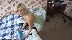 Blond-haired beauty in a dress showing her killer curves while packing