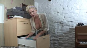 Blond-haired cutie flashing a hint of her nipples while doing stuff