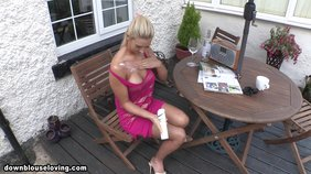 Pink dress blond-haired beauty with a ponytail flashing tits outdoors