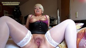 Short-haired MILF ex-GF in a corset masturbating
