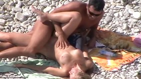 Busty blond-haired nudist getting viciously fucked sideways on a nudist beach