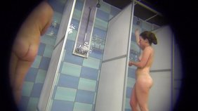 Slender big booty brunette takes a shower and looks hot while doing so