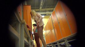 Spunky and sporty blond-haired chick showing off in the changing room