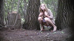 Pale-skinned blonde amateur furiously peeing in the middle of nowhere