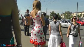 Upskirt video featuring a dress-wearing blond-haired amateur at a bus stop